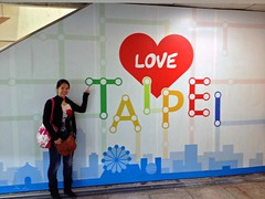 "Mei in Taipei Main Station by a ""Love Taipei"" sign"