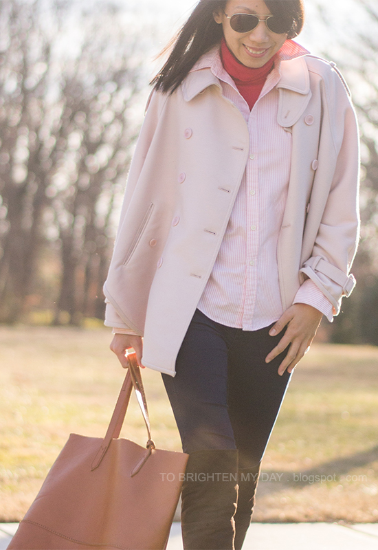 pink trench cape, red turtleneck, pink striped button up shirt, cognac brown tote