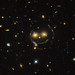 Hubble Sees A Smiling Lens by NASA Goddard Photo and Video