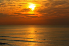 fisherman's boat in a golden sea - Tel-Aviv beach