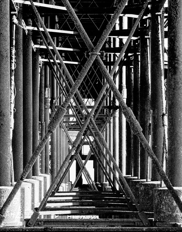black and white photo underneath penarth pier