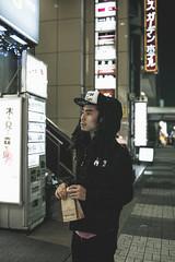 Street skater outside of liquor shop in tokyo