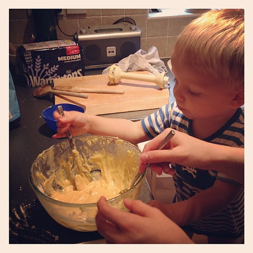 Making cakes with his big sister.