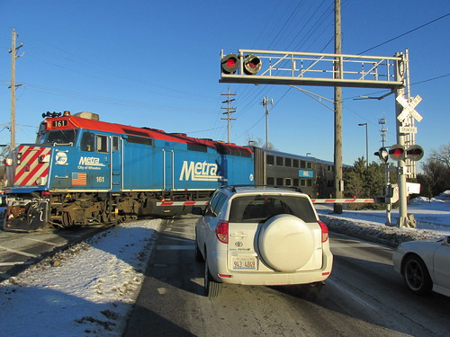 Outbound Metra afternoon express commuter train crossing Oakton Street.  Park Ridge Illinois.  Wednsday, January 29th, 2014. by Eddie from Chicago