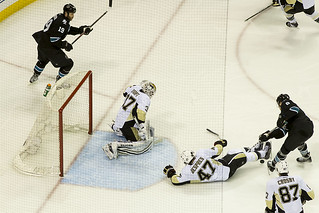 Simon Despres blocks a shot from Joe Pavelski