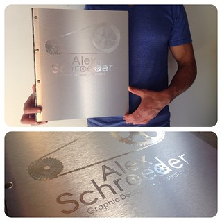 Custom graphic design portfolio book with silver on silver engraving on brushed silver aluminum