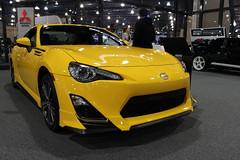 toyota(0.0), exhibition(0.0), automobile(1.0), toyota 86(1.0), automotive exterior(1.0), wheel(1.0), vehicle(1.0), automotive design(1.0), scion(1.0), auto show(1.0), bumper(1.0), land vehicle(1.0), coupã©(1.0), supercar(1.0), sports car(1.0),