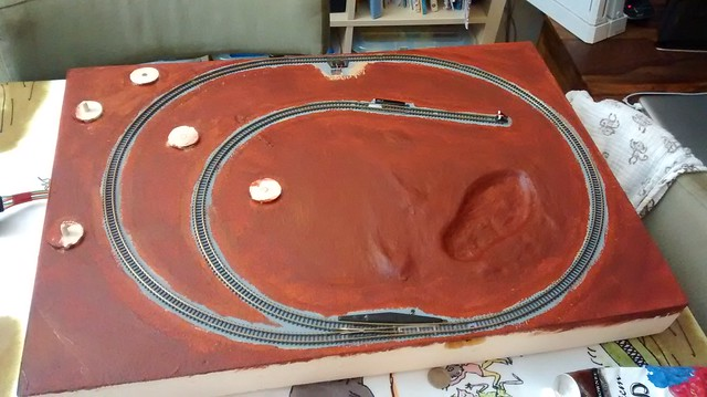 Applying undercoat to train layout