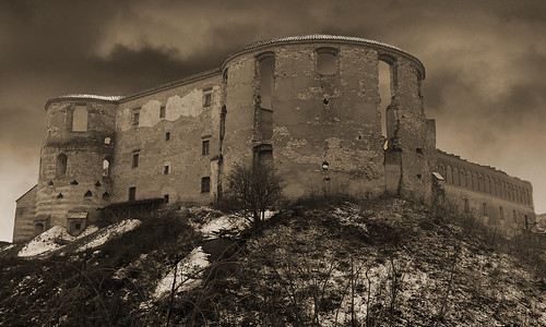 The ruins of the castle in Janowiec in the clouds - sepia