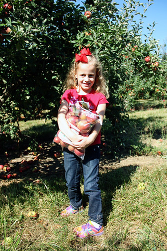 Apple_Holding-her-bag-of-apples