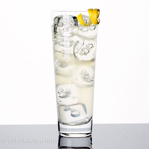 French 75 Cocktai with lemon twist garnish in tall glass with ice