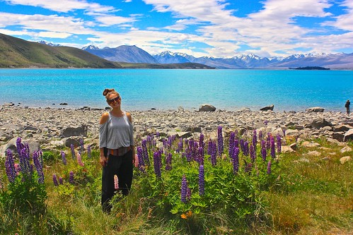 Lina with Lupine flowers in front of Lake Tekapo