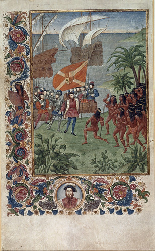 Untitled - caption: 'Hernando Cortes landing in Mexico in 1519, met by natives; with foliate borders and a portrait of Cortes in a medallion.'
