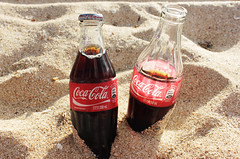 alcoholic beverage(0.0), soft drink(1.0), carbonated soft drinks(1.0), bottle(1.0), drink(1.0), cola(1.0), coca-cola(1.0),