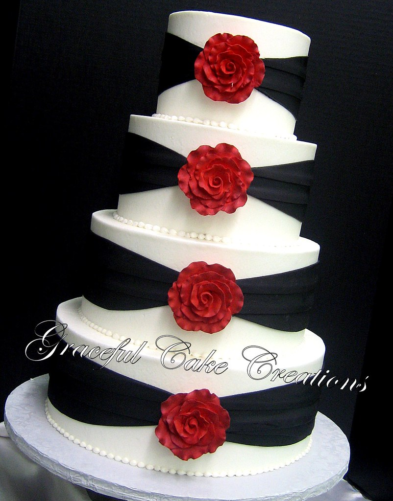 Elegant White And Black Wedding Cake With Red Roses A Photo On