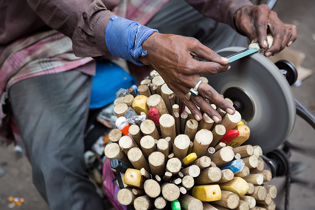 Hands of a knife sharpener in Mumbai, India.