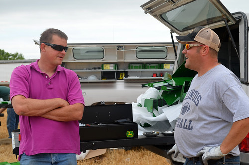 Leon chats with a John Deere employee in the PIP program