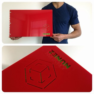 Custom photograhy book in red acrylic with engraving and cut-out treatment