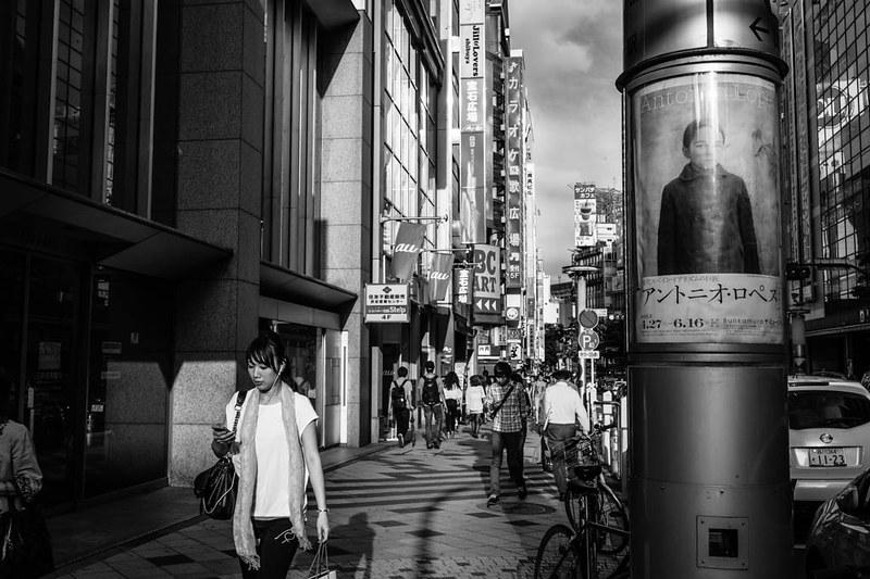 A woman and a poster. Shibuya, Tokyo