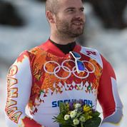 Jan hudec stands on the podium during the flower ceremony in Sochi, RUS