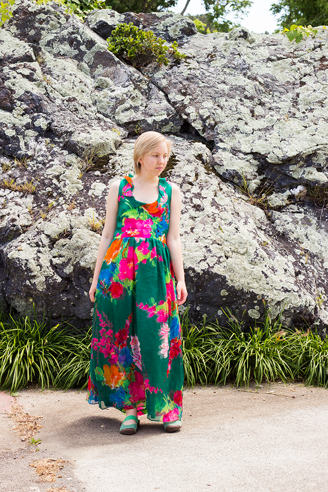 bright pink and green vintage maxi dress, rock covered with lichen