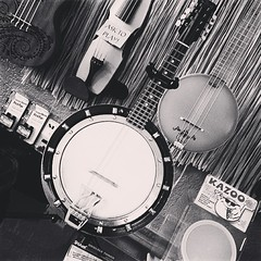 watch(0.0), acoustic guitar(0.0), guitar(0.0), drums(0.0), drum(0.0), electronic instrument(0.0), plucked string instruments(1.0), monochrome photography(1.0), circle(1.0), monochrome(1.0), black-and-white(1.0), banjo(1.0), string instrument(1.0),