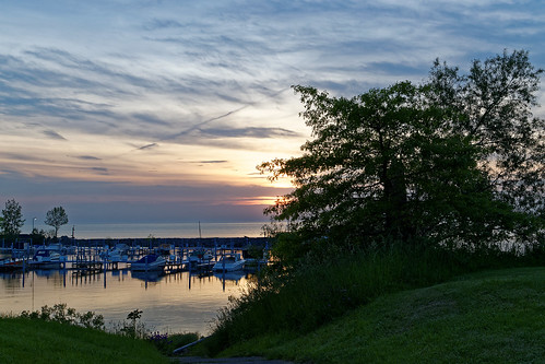 blue sunset ohio sky sun lake tree green water boats dock lakeerie outdoor cleveland breakwall