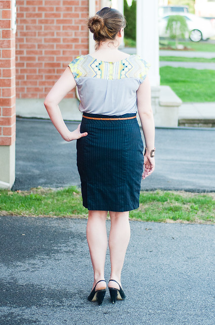 navy skirt neon print top black shoes