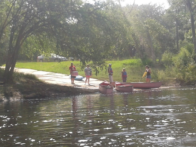 Canoes entering the water