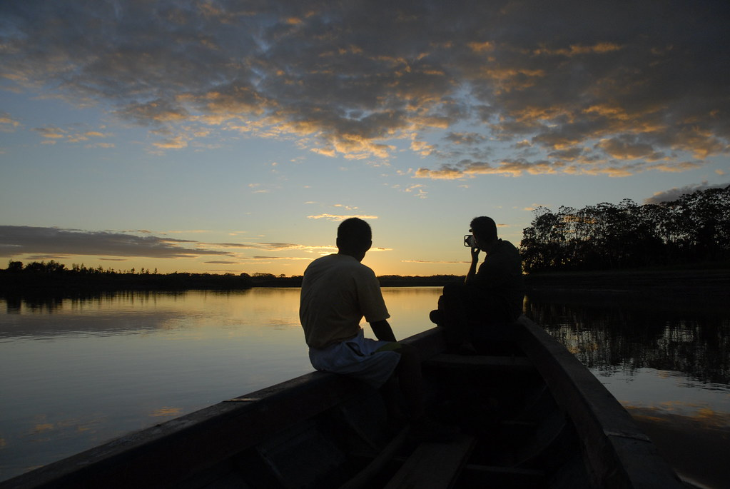 Canoe exploring deep in the Amazon rainforest during our wildlife tours.