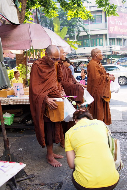 tak bat, morning alms, monk blessing, Bangkok, Thailand