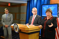 With Department Spokesperson John Kirby and Assistant Secretary of State for East Asian and Pacific Affairs Daniel Russel looking on, Under Secretary of State for Economic Growth, Energy, and the Environment Catherine Novelli responds to a reporter's question as she and Assistant Secretary Russel previewed the U.S.-China Strategic and Economic Dialogue at the top of the Daily Press Briefing at the U.S. Department of State in Washington, D.C., on May 31, 2016. [State Department photo/ Public Domain]