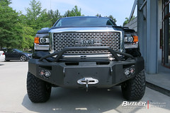 GMC Denali with 20in Fuel Maverick Wheels and Toyo OPMT Tires with Fabfour Front and Rear Bumpers and 7in Rough Country Lift