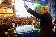 U.S. Secretary of State John Kerry waves to the crowd that assembled to greet him on May 24, 2016, after he attended a dinner at the Bitexco Tower in Ho Chi Minh City, Vietnam, to celebrate the licensing of the U.S.-supported Fulbright University Vietnam. [State Department photo/ Public Domain]