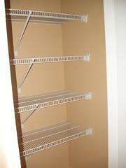 furniture(0.0), wall(0.0), wood(0.0), ceiling(0.0), glass(0.0), shelving(1.0), shelf(1.0), room(1.0), display case(1.0),