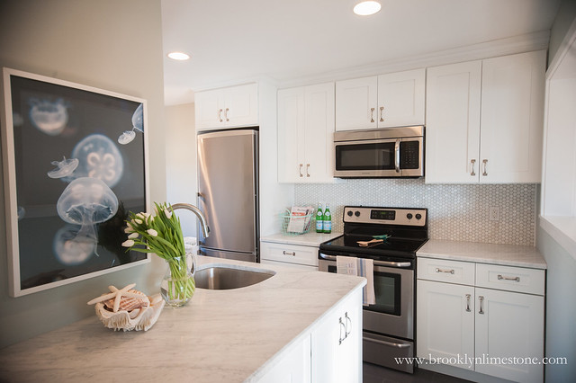 This coastal kitchen makeover made this kitchen much brighter, beachy (without being too over the top thematic) and functional.
