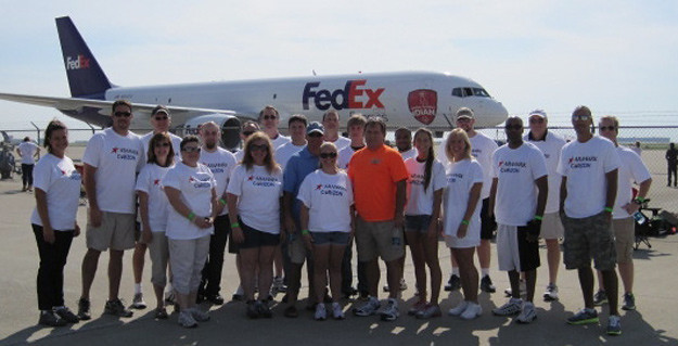 Indiana Corizon team pulls a FED/EX plane for charity