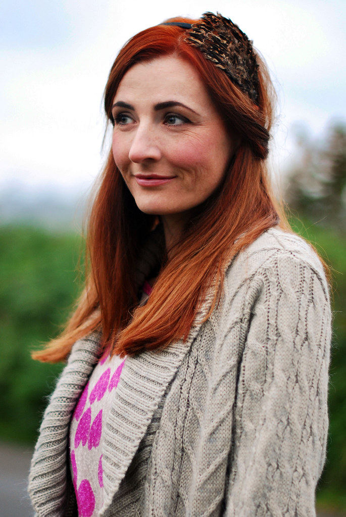Red hair, grey cable knit