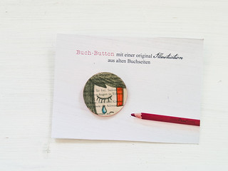 an illustrated brooch out of book sheets
