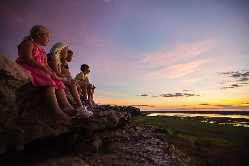 Kids enjoying the sunset at Ubirr, East Alligator - Photo by Parks Australia