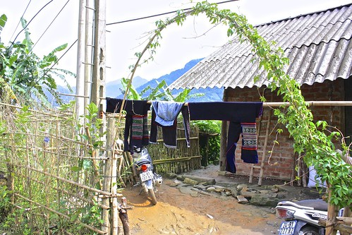 traditional Black Hmong women's clothes are hung out to dry
