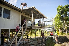 New Zealand Army Engineers and students at the Tabaka Rural Training Centre on Banga Island renovate a building at the center Aug. 7 during a Pacific Partnership 2013 engineering project. (U.S. Navy photo by Mass Communication Specialist 2nd Class Tim D. Godbee/Released)