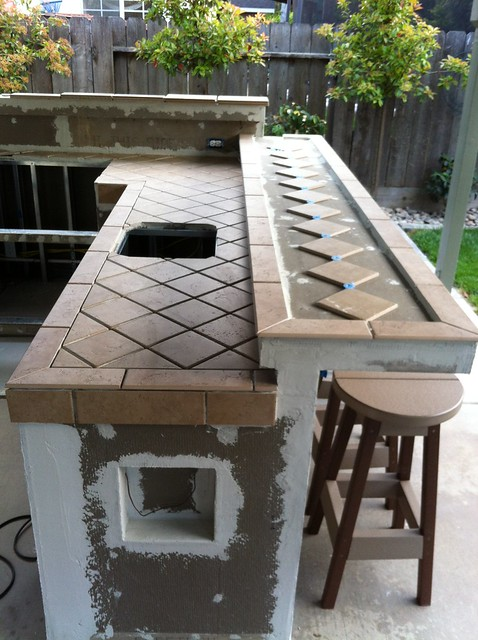 The Back Splash Behind The BBQ Section Has Been Tiled With A Glass Mosaic  Tile.
