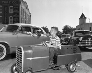 Unidentified boy in a go-kart in a parade: Quincy, Florida