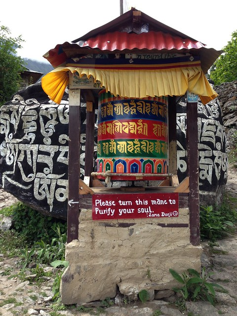 Buddhist mani stone and prayer wheel along the Everest Base Camp trail