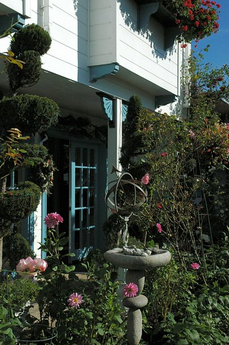 Happy Saint Valentine's Day! bird bath, armillary celestial astrolabe with small globe and arrow, flowers, topiary, open French doors, Mill Rose Inn, Half Moon Bay, California, USA by Wonderlane