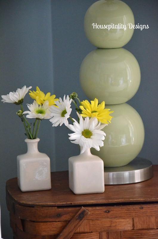 Spring flowers on a stack of vintage picnic baskets