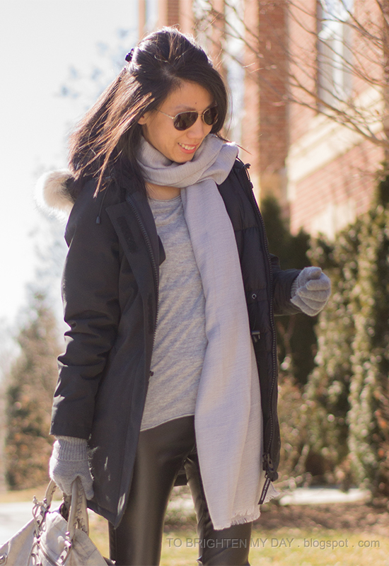 black parka, gray scarf, gray tee, black faux leather pants