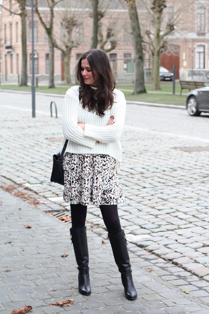 office appropriate outfit: knee boots, sweater, printed skirt