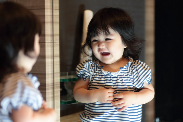 Baby in Front of a Mirror,Smiling
